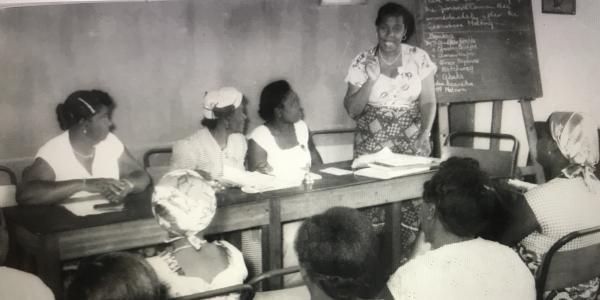 Amarteifio addresses members at a monthly Meeting, 1956